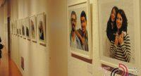 Ausstellungswand mit Fotos, Quelle: DTF